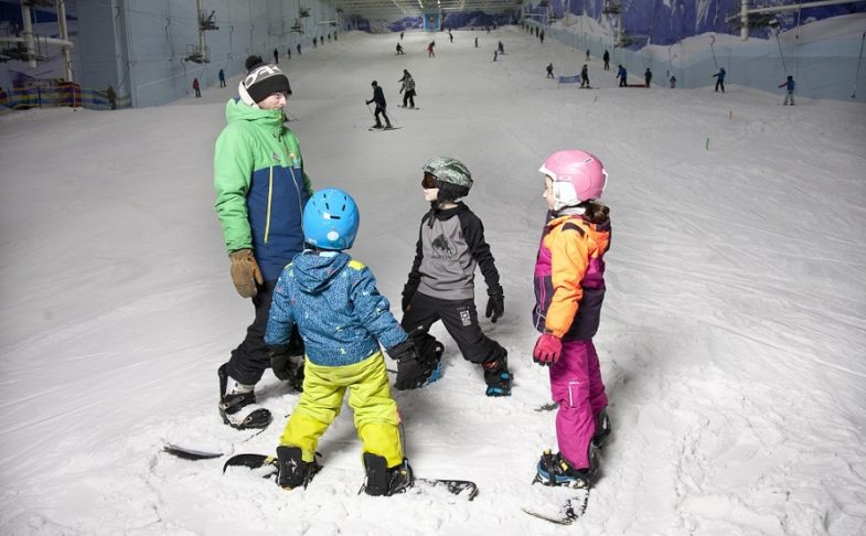 Three children with an instructor on the slope at Chill Factore