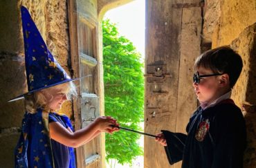 A boy and girl dressed in Halloween costume for the Little school of sorcery at Haddon Hall.