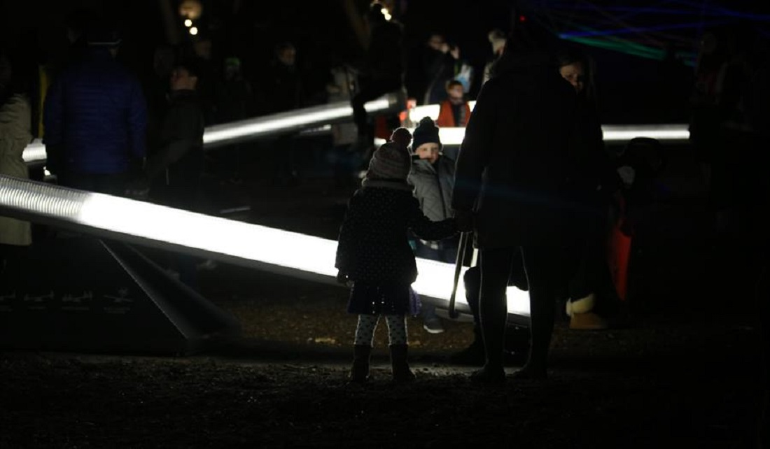 People on light up seesaw as part of Wave-Field exhibit