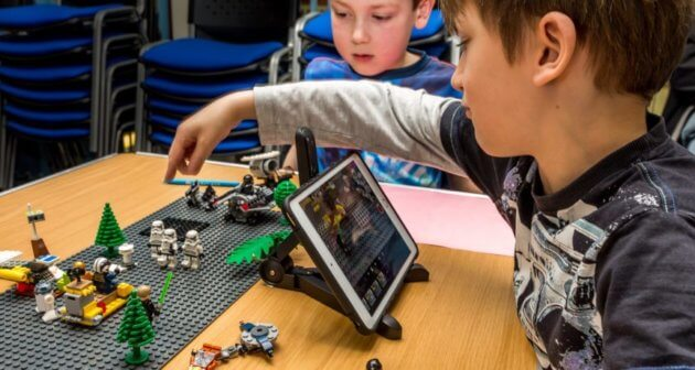 Boy handling Lego during the Lego animation workshop at Manchester Animation Festival