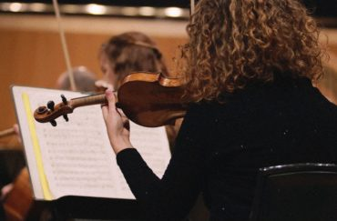 A violin player - part of the Halle's Christmas Family Concert