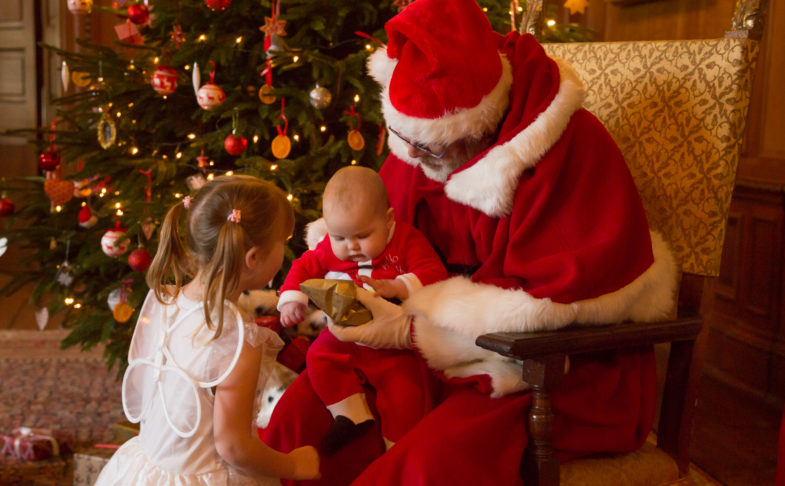 A baby on Santa's knew, part of An afternoon audience with Father Christmas