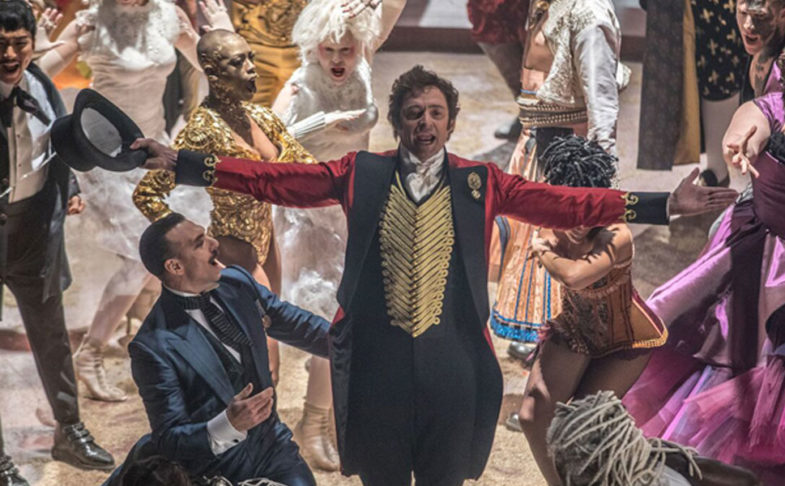 Hugh Jackman singing in a scene from The Greatest Showman