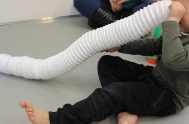 Boy playing with a tube in the SEND friendly sessions