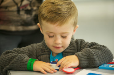 Little boy making something at the space crafts event
