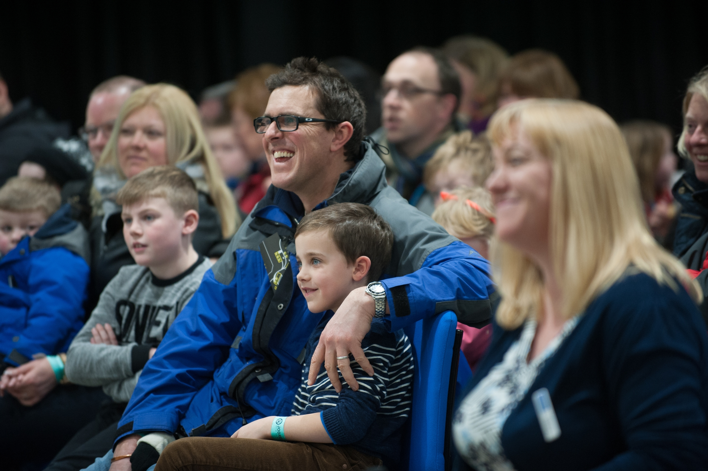 A smiling audience at a meet the expert and science show event
