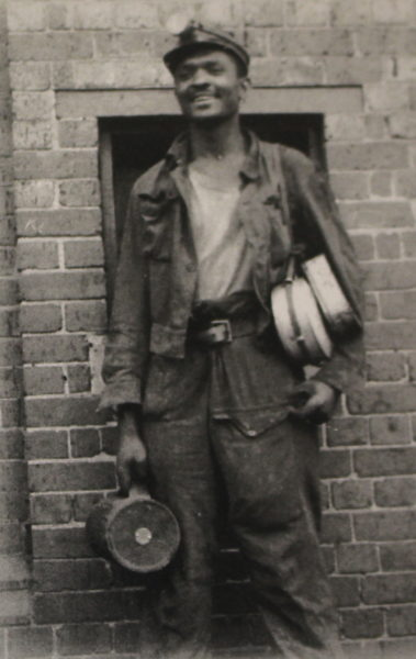 Black miner in old photograph from Digging Deep exhibition