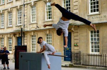 An performer doing acrobatics on a box