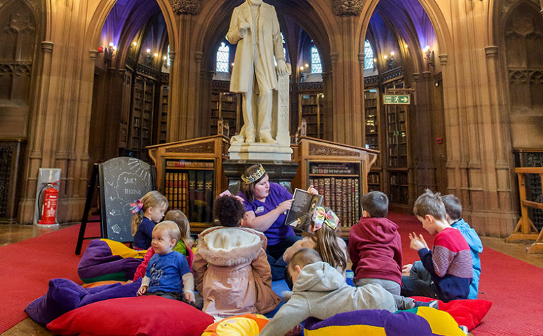 Children sat on cushions in Toddler Tales session