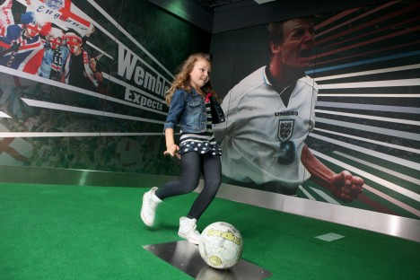 A young visitor tries out the activities at Manchester's National Football Museum