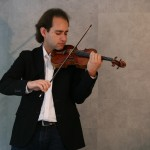 Manchester Camerata leader Giovanni Guzzo performs on a 1709 Stradivarius